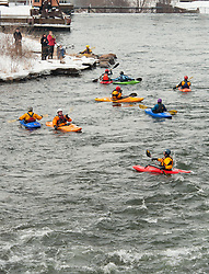 Kayakers navigate to the take out area following a run down the Winnipesaukee River on Saturday, January 1, 2011.  (Alan MacRae/for the Monitor)