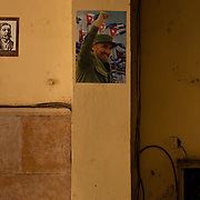 Posters of Pedro Agustin Perez Perez,  left, and Fidel Castro, center, in the entryway of a government building, Havana, Cuba. Photo by Jen Klewitz