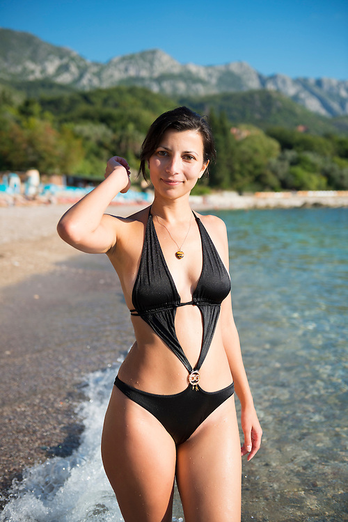 Katerina, from Serbia, at the beach in her Dolce & Gabbana swimsuit near Budva, Montenegro