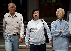 © London News Pictures. 08/05/2012. London, UK. L to R Loh Ah Choi, Chong Koon Ying and Lim Ah Yin , Family of Malaysians killed by British soldiers leaving The High Court in London on May 08, 2012. The Family members of 24 villagers killed by UK troops  when Malaya was part of the British Empire are seeking an inquiry into their deaths which they claim were 'cold-blooded mass murder'. The judicial review is to be held on 8th and 9th of May. Photo credit: Ben Cawthra/LNP