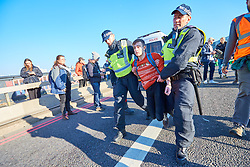 © Licensed to London News Pictures. 17/11/2018. LONDON, UK.  Police arrest protesters from Extinction Rebellion for obstruction of the highway after they blocked Lambeth Bridge calling for increased Government action on climate change. The group hopes to block five central London bridges today (Sat)  after engaging in a series of civil disobedience during the last week.  Photo credit: Cliff Hide/LNP