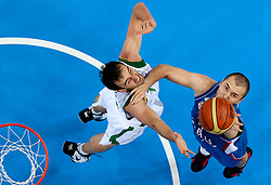Mirza Begic of Slovenia vs Milan Macvan of Serbia during basketball game between National basketball teams of Slovenia and Serbia in 7th place game of FIBA Europe Eurobasket Lithuania 2011, on September 17, 2011, in Arena Zalgirio, Kaunas, Lithuania. Slovenia defeated Serbia 72 - 68 and placed 7th. (Photo by Vid Ponikvar / Sportida)