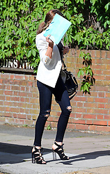 A camera shy Abbey Clancy wearing a white blazer jacket, very tight ripped jeans and laced up shoes out in north London, UK. 07/05/2014<br />BYLINE MUST READ : GOTCHAIMAGES.COM<br /><br />Copyright by © Gotcha Images Ltd. All rights reserved.<br />Usage of this image is conditional upon the acceptance <br />of Gotcha Images Ltd, terms and conditions available at<br />www.gotchaimages.com