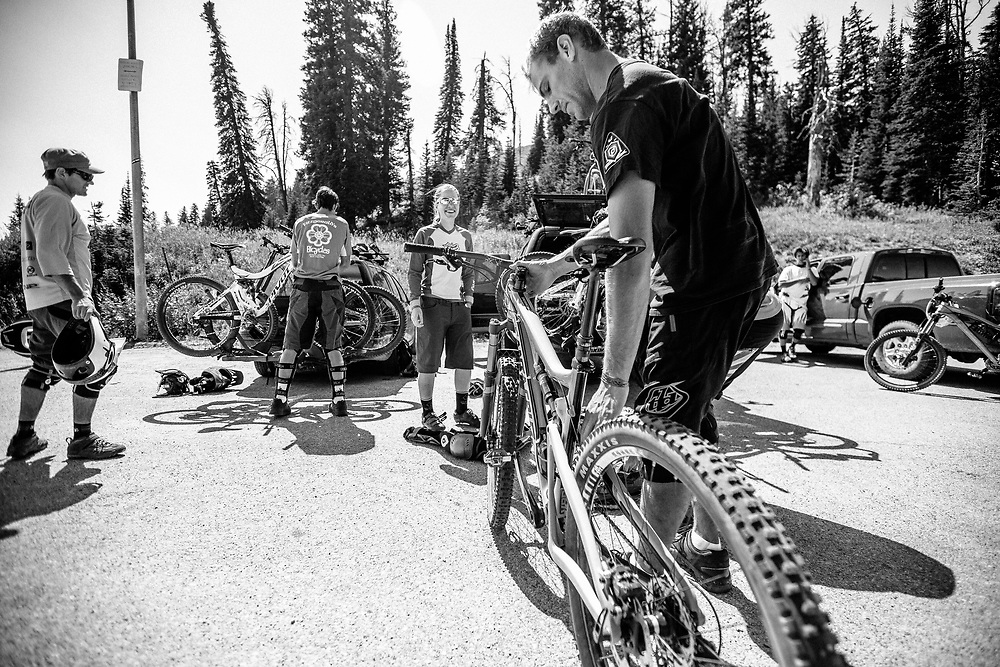 A group of downhill mountain bike riders plan their next assualt off Teton Pass near Wilson, Wyoming.