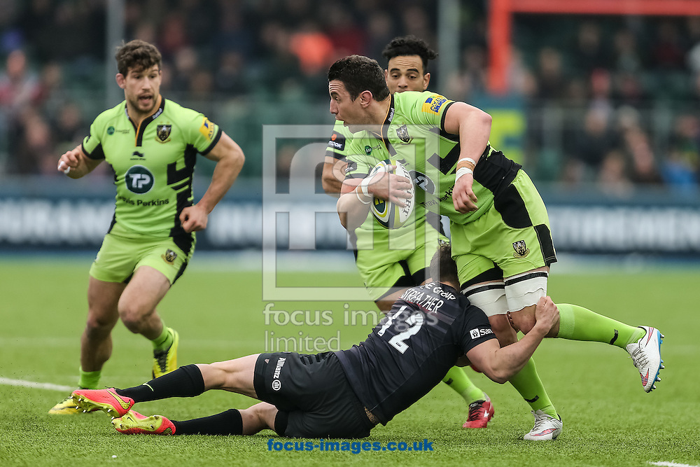 Phil Dowson of Northampton Saints (right) is tackled by Tim Streather of Saracens (centre) during the LV Cup semi final match at Allianz Park, London<br /> Picture by Andy Kearns/Focus Images Ltd 0781 864 4264<br /> 14/03/2015