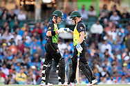 SYDNEY - NOVEMBER 25: Australian player Aaron Finch (c) and Australian player D'Arcy Short touch gloves at the International Gillette T20 cricket match between Australia and India at The Sydney Cricket Ground in NSW on November 25, 2018. (Photo by Speed Media/Icon Sportswire)