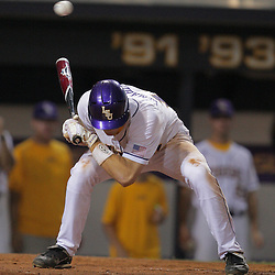 09 June 2008:  D.J. LeMahieu of LSU ducks to keep from getting hit by a pitch in the bottom of the fifth inning against UC Irvine. The LSU Tigers advanced to the College World Series with a 21-7 victory over the UC Irvine Anteaters in game three of the NCAA Baseball Baton Rouge Super Regional Alex Box Stadium in Baton Rouge, LA..