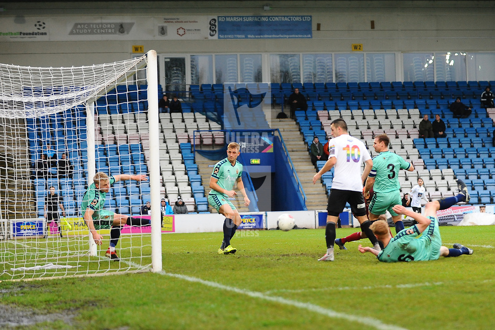 TELFORD COPYRIGHT MIKE SHERIDAN Jamie Chandler of Spennymoor clears Adam Walkers shot off the line during the Vanarama National League Conference North fixture between AFC Telford United and Spennymoor Town on Saturday, November 16, 2019.<br /> <br /> Picture credit: Mike Sheridan/Ultrapress<br /> <br /> MS201920-030
