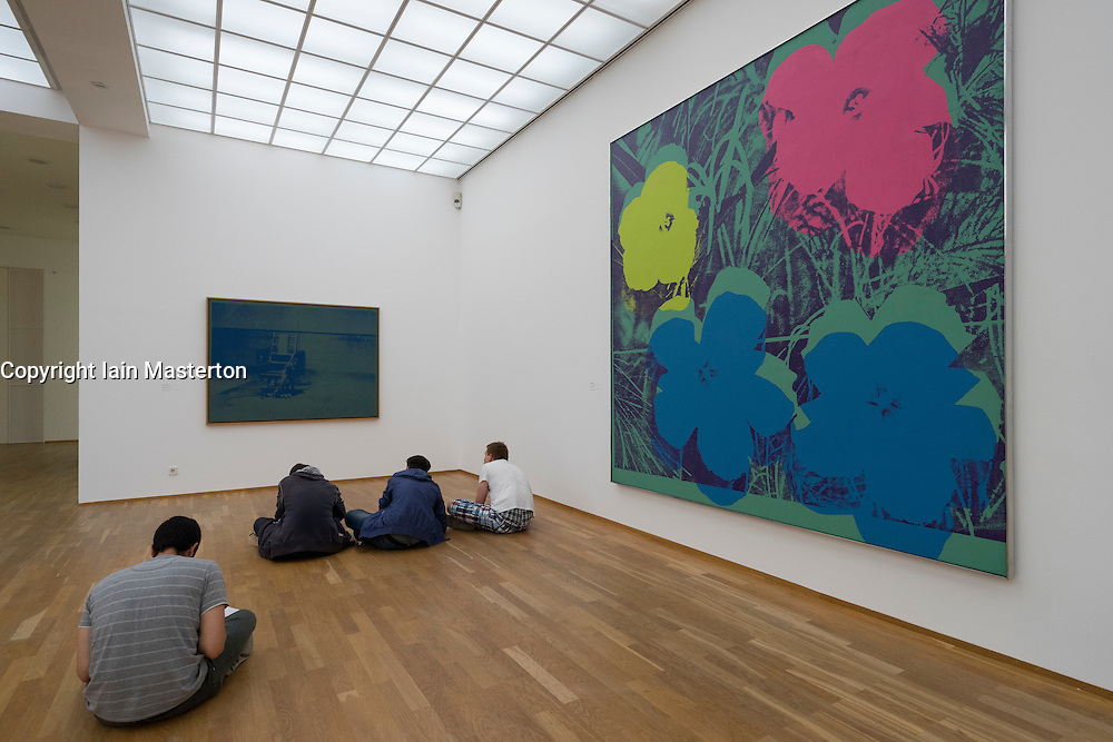 Students copying art by Andy Warhol inside Hamburger Bahnhof modern art museum in Berlin Germany