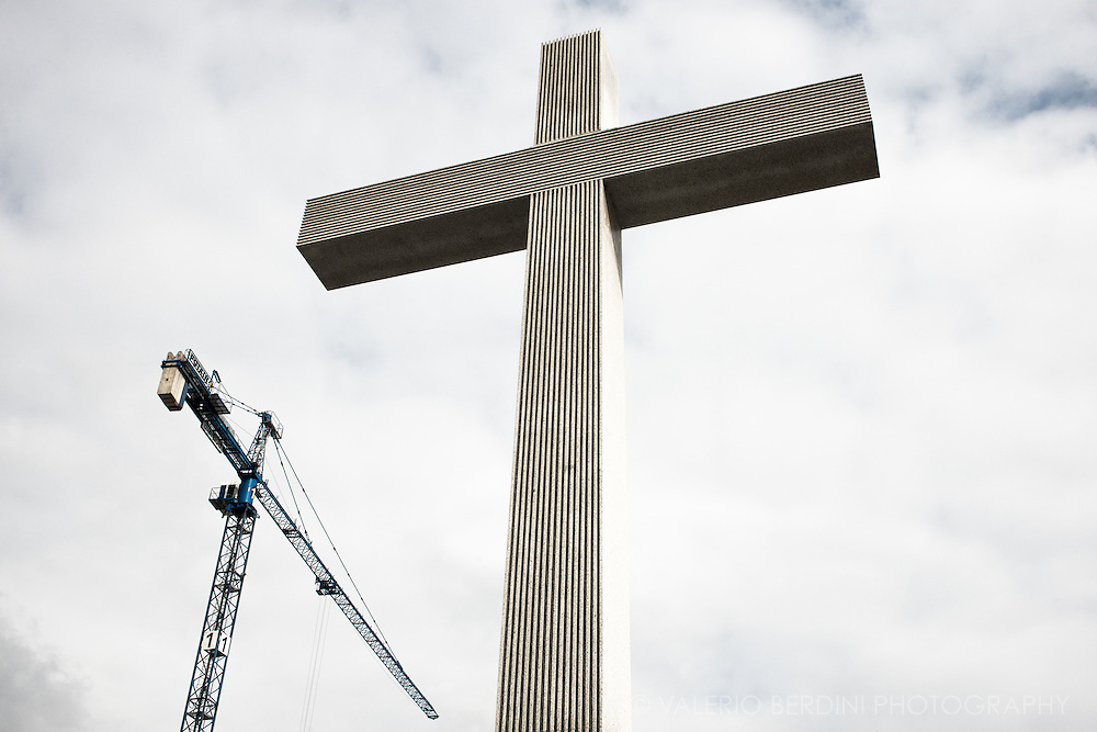 A giant crane and a giant cross stand side by side in Pilsudski Square. Piłsudski Square in 1979 was the place where Pope John Paul II addressed a large gathering of his countrymen at an open-air Holy Mass during his first visit to Poland soon after his 1978 elevation to the papacy. In April 2005, his death was mourned there also. Construction sites are very active in Warsaw, new building are renewing and refreshing the city skyline.