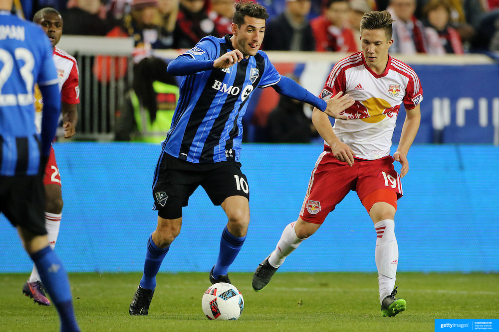 HARRISON, NEW JERSEY- November 06:  Ignacio Piatti #10 of Montreal Impact is challenged by Alex Muyl #19 of New York Red Bulls during the New York Red Bulls Vs Montreal Impact MLS playoff match at Red Bull Arena, Harrison, New Jersey on November 06, 2016 in Harrison, New Jersey. (Photo by Tim Clayton/Corbis via Getty Images)