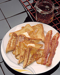 breakfast plate french toast two strips bacon melted butter syrup Cuisine Bon Appetit