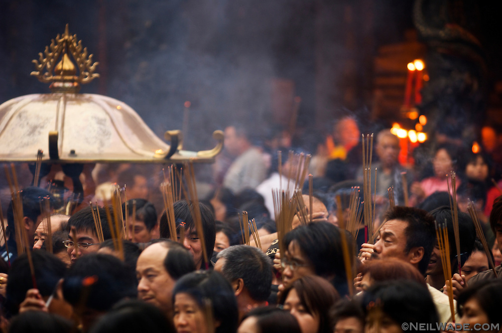 Praying at Lungshan Temple in Taipei, Taiwan is considered to be very lucky on the first day of Chinese Lunar New Year.  Many people burn incense as they pray to the various dieties of the temple.