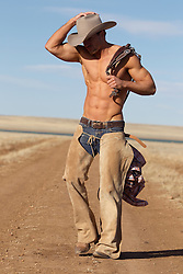 sexy shirtless cowboy on a ranch in New Mexico