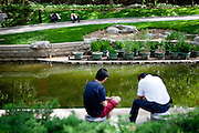 "People relaxing in a park close to the ""The Forbidden City"" in the center of Beijing. Beijing is the capital of the People's Republic of China and one of the most populous cities in the world with a population of 19,612,368 as of 2010."