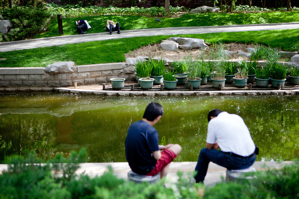 """People relaxing in a park close to the """"The Forbidden City"""" in the center of Beijing. Beijing is the capital of the People's Republic of China and one of the most populous cities in the world with a population of 19,612,368 as of 2010."""