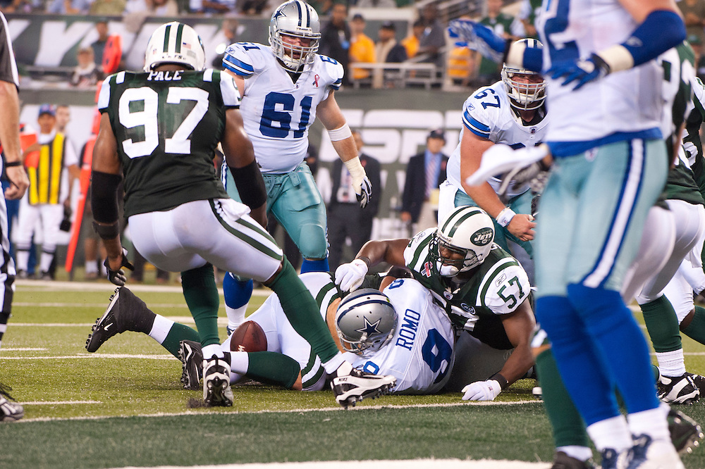 EAST RUTHERFORD, NJ - SEPTEMBER 11: Tony Romo #9 of the Dallas Cowboys is sacked during the game against the New York Jets at MetLife Stadium on September 11, 2011 in East Rutherford, New Jersey. The Jets defeated the Cowboys 27 to 24. (Photo by Rob Tringali) *** Local Caption *** Tony Romo