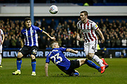 Sheffield United midfielder John Fleck (4) goes past Sheffield Wednesday defender Sam Hutchinson (23)  during the EFL Sky Bet Championship match between Sheffield Wednesday and Sheffield United at Hillsborough, Sheffield, England on 4 March 2019.