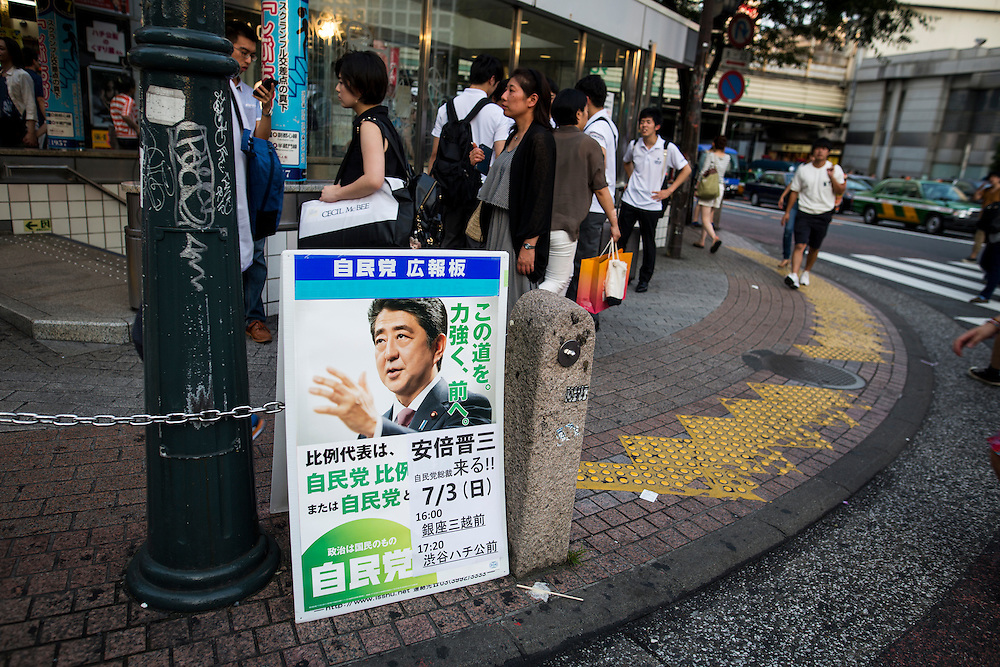 TOKYO, JAPAN - JULY 03 : A poster of Japanese Prime Minister Shinzo in crossing Shibuya before the election campaign of Liberal Democratic Party in Shibuya crossing, Tokyo prefecture, Japan, on July 3, 2016. (Photo by Richard Atrero de Guzman/ANADOLU AGENCY)