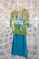 Dress with papercut works by American artist Tahiti Perhson in the background in Mouki Mou shop window, 29 Chiltern Street, Marylebone, Londres. Created by Maria Lemos.