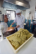 "Kantetsu Jahana  fills a tray with the dough  that makes traditional ""kippan"" confectionery, which is made from the kaabuchi citrus fruit, at the Janaha Kippan-ten store in Naha, Okinawa, Japan on 27 June 2012. Today the Jahana family are the only people still making the traditional Kippan and Tougatsuke (which is made from ""tougan"" winter melons) sweets that were served at the court of the Ryukyu kings over 300 years ago. Photo: Robert Gilhooly."