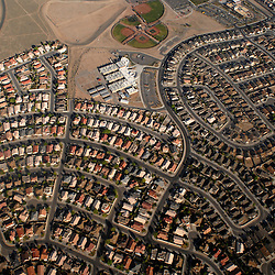 Rows of house line up on the east side of Albuquerque. The city has taken significant steps to control urban sprawl and limit the forming of geopolitical boundaries that many large cities suffer from. .