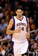 Oct. 12, 2012; Phoenix, AZ, USA; Phoenix Suns forward Luis Scola (14) runs up the court during the game  against the Portland Trail Blazers at US Airways Center. The Suns defeated the Trail Blazers 104-93.  Mandatory Credit: Jennifer Stewart-US PRESSWIRE