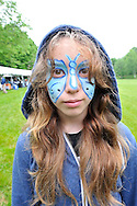 Emma with face paint on the lawn at Riverkeeper's Shad Fest