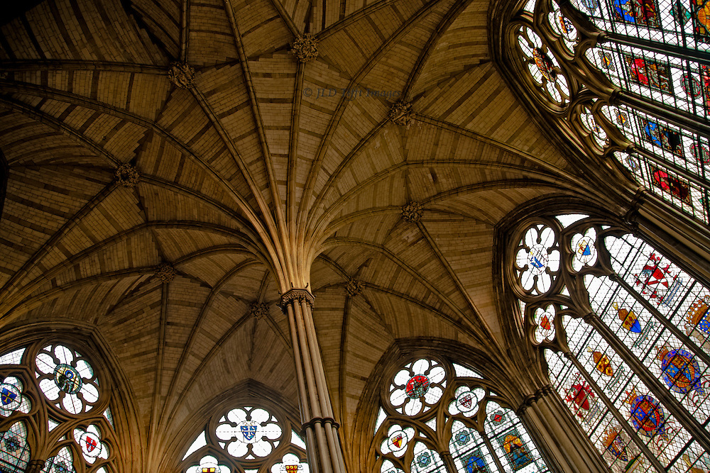 Vaulted ceiling of the restored Chapter House, Westminster Abbey, London.  Emphasizes the radiating ribs and surrounding stained glass (modern replacements).  The structure was built in the 13th century; restored in the Victorian period.  The Chapter House is entered from the abbey cloister.