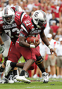 COLUMBIA - SEPTEMBER 11:  Tailback Marcus Lattimore #21 of the South Carolina Gamecocks runs with the ball while guard Rokevious Watkins #73 looks on during the game against the Georgia Bulldogs at Williams-Brice Stadium on September 11, 2010 in Columbia, South Carolina.  The Gamecocks beat the Bulldogs 17-6.  (Photo by Mike Zarrilli/Getty Images)
