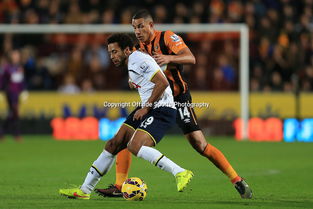 23rd November 2014 - Barclays Premier League - Hull City v Tottenham Hotspur - Jake Livermore of Hull battles with Mousa Dembele of Spurs - Photo: Simon Stacpoole / Offside.