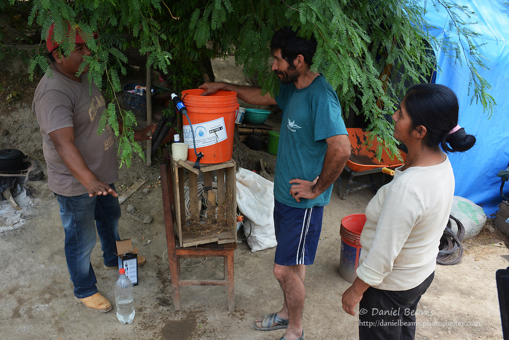 Demonstrating the Sawyer water filter in Moro Moro, Santa Cruz, Bolivia