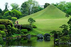 Traditional Japanese garden at Suizenji with miniature Mount Fuji to rear