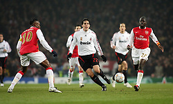 LONDON, ENGLAND - Wednesday, February 20, 2008 : Arsenal's William Gallas (left) and Emmanuel Eboue in action against AC Milan's Kaka during the UEFA Champions 1st Knockout Round, 1st Leg match at The Emirates Stadium. (Photo by Chris Ratcliffe/Propaganda)
