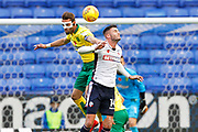 Norwich City defender Ivo Pinto (2) and Bolton Wanderers striker Gary Madine (14) during the EFL Sky Bet Championship match between Bolton Wanderers and Norwich City at the Macron Stadium, Bolton, England on 4 November 2017. Photo by Craig Galloway.