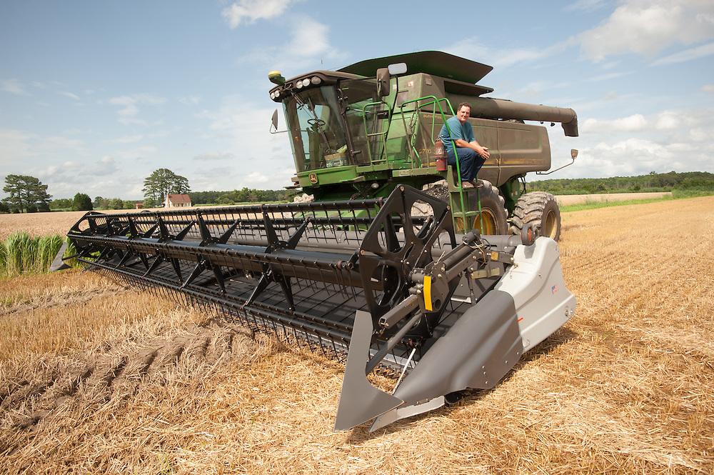 Farmer sitting on combine harvester<br /> Princess Anne, MD