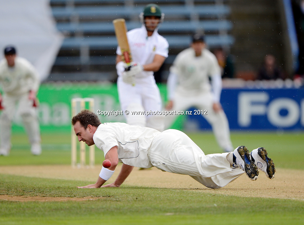 Mark Gillespie falls over as he tries to field as South Africa's Jean-Paul Duminy looks on. Test match cricket. Third Test, Day 2. New Zealand Black Caps versus South Africa Proteas, Basin Reserve, Wellington, New Zealand. Saturday 24 March 2012. Photo: Andrew Cornaga/Photosport.co.nz