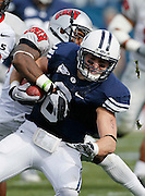 BYU wide receiver McKay Jacobson (6) is tackled by UNLV cornerback Mike Grant after catching a 19-yard Jake Heaps pass during the first half of an NCAA college football game at LaVell Edwards Stadium, Saturday, Nov. 6, 2010, in Provo, Utah.  BYU defeated UNLV 55-7. (AP Photo/Colin E. Braley)