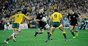 Kieran Read charges at the Wallabies defense, Rugby Championship. Australia v All Blacks at ANZ Stadium, Sydney, New Zealand. Saturday 18 August 2012. New Zealand. Photo: Richard Hood/photosport.co.nz