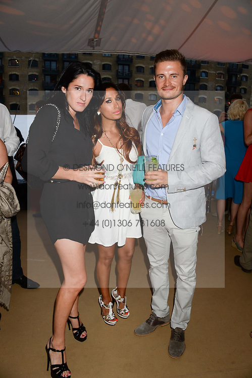 The Johnnie Walker Gold Label Reserve Party aboard John Walker & Sons Voyager, St.Georges Stairs Tier, Butler's Wharf Pier, London, UK on 17th July 2013.<br /> Picture Shows:-Amy Molyneaux, Preeya Kalidas and Sam Vallance