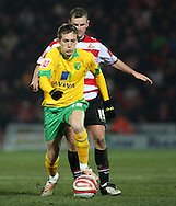 Doncaster - Friday January 30th 2009:Arturo Lupoli of Norwich City & Richie Wellens of Doncaster Rovers in action during the Coca Cola Championship Match at The Keepmoat Stadium Doncaster. (Pic by Steven Price/Focus Images)