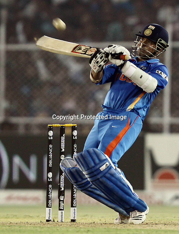 Indian batsman Sachin Tendulkar plays a shot against Australia during the 2nd Quarter-Final match India v Australia Played at Sardar Patel Stadium, Motera, Ahmedabad 24 March 2011 - day/night (50-over match)