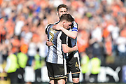 Notts County defender Elliott Hewitt (4) embraces Notts County defender Matt Tootle (2) during the EFL Sky Bet League 2 match between Notts County and Luton Town at Meadow Lane, Nottingham, England on 5 May 2018. Picture by Jon Hobley.