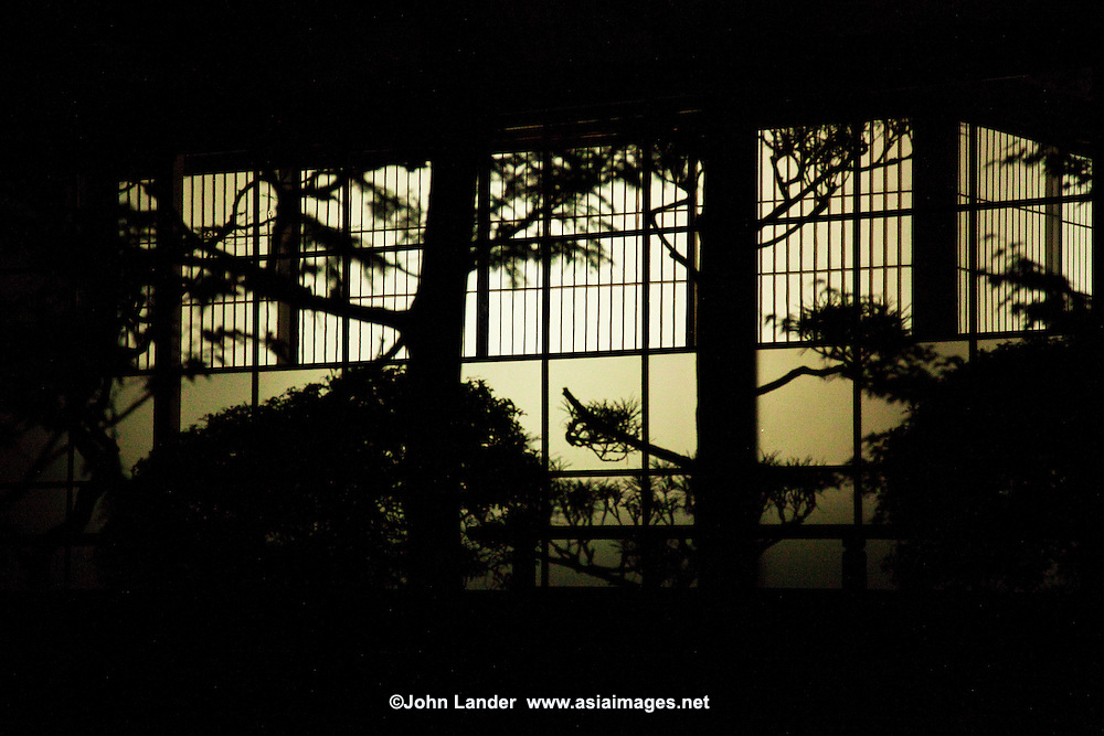Shoji silhouette at Ekoin Temple, Koyasan. In traditional Japanese architecture, a shoji is a door, window or room divider consisting of translucent paper over a frame of wood or bamboo. Shoji doors are designed to slide open, and thus conserve space that would be required by a swinging door. They are used in traditional houses especially in the washitsu  or Japanese-style room.