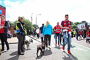 Security with sniffer dogs check fans as they arrive before the Michael Carrick Testimonial Match between Manchester United 2008 XI and Michael Carrick All-Star XI at Old Trafford, Manchester, England on 4 June 2017. Photo by Phil Duncan.