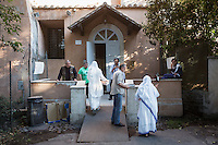 ROME, ITALY - 27 AUGUST 2016: Sisters of the Missionaries of Charity, the religious congregation founded by Mother Teresa in 1950, bring food at the accommodation center they run at San Gregorio al Celio, which hosts homeless men, in Rome, Italy, on August 27th 2016.<br /> <br /> Mother Teresa, also known as Blessed Teresa of Calcutta, was an Albanian Roman Catholic nun and missionary. She founded the Missionaries of Charity, a Roman Catholic religious congregation, whose members must adhere to the vows of chastity, poverty, and obedience, as well as the vow to give wholehearted free service to the poorest of the poor. Shortly after she died in 1997, Pope John Paul II waived the usual five-year waiting period and allowed the opening of the process to declare her sainthood. She was beatified in 2003. A second miracle was credited to her intercession by Pope Francis, in December 2015, paving the way for her to be recognised as a saint by the Roman Catholic Church. Her canonisation is scheduled for September 4th 2016, a day before the 19th anniversary of her death.