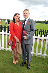 SIR KENNETH BRANAGH and LINDSAY BRUNNOCK at the Cartier Queen's Cup Polo Final, Guards Polo Club, Windsor Great Park, Berkshire, on 17th June 2012.