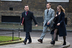© Licensed to London News Pictures. 19/12/2017. London, UK. Secretary of State for Wales Alun Cairns (L) arrives on Downing Street for the weekly Cabinet meeting. Photo credit: Rob Pinney/LNP