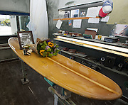 March 29, 2014 - Dana Point, California, USA - <br /> <br /> Surf Pioneer Hobie Alter Dead at 80<br /> <br />  Flowers, along with a lone candle and a photo of surfing pioneer Hobie Alter, were placed on an original Hobie long board in the shaping room of the Dana Point Hobie Surf Shop, as a tribute to his death from cancer, at 80. Alter's first retail surf shop was located on the other side of Pacific Coast Highway from the current Dana Point Hobie Surf Shop<br /> ©Exclusivepix