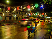 22 NOVEMBER 2017 - YANGON, MYANMAR: Christmas lights hang over  Bogyoke Aung San Road, in front of Bogyoke Aung San Market in Yangon. Although Christmas is not widely celebrated in Buddhist majority Myanmar, the country's expanding tourist industry and booming retail trade have led to more Christmas displays in areas that cater to foreigners.     PHOTO BY JACK KURTZ